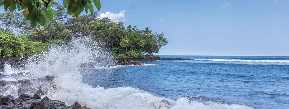 Waves crashing on the coast of a Hawaiian Beach